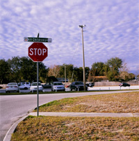 Photograph of the Sunnyland Hospital in Florida parking lot, from a photo series